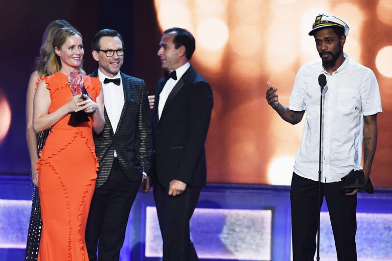 Keith Stanfield (right) of the show Atlanta  crashes the stage at the Critics' Choice Awards on Dec. 11, 2016, as actors Leslie Mann and Christian Slater and producer Tom Lassally accept the award for Best Comedy Series for Silicon Valley.  Ethan Miller/Getty Images