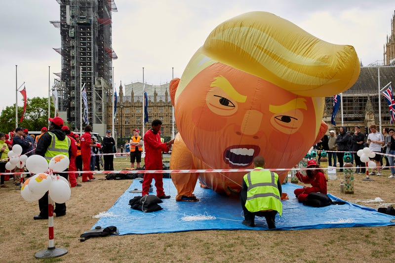 Trump Babysitters inflate a large Trump Baby Blimp in Parliament Square outside Westminster on June 4, 2019 in London, England.