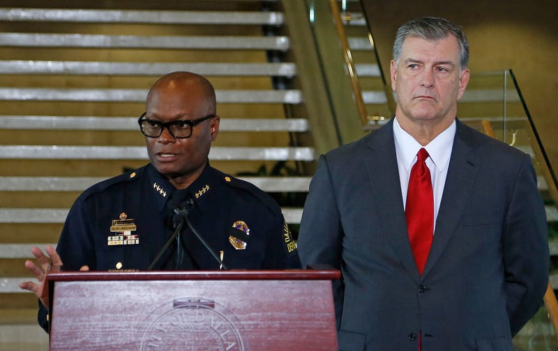 As Dallas Mayor Mike Rawlings (right) looks on, Dallas Police Chief David Brown speaks at Dallas City Hall on July 8, 2016,  about the fatal shootings of five Dallas police officers.Stewart F. House/Getty Images
