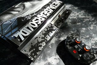 Illustration for article titled Custom Metal Gear Solid 4 PS3 Is Full Of Awesome Substance