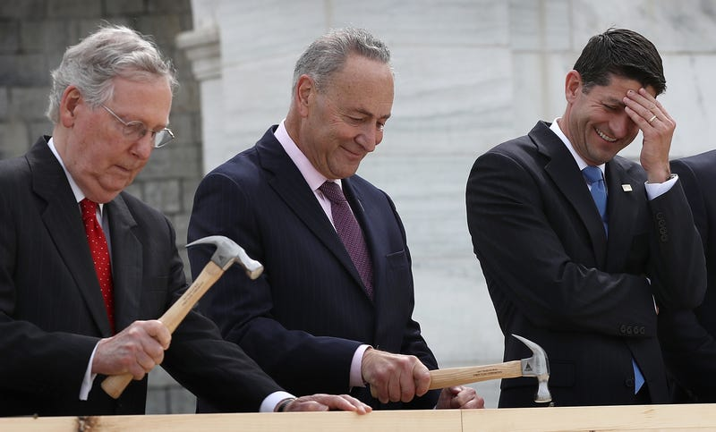 Speaker of the House Paul Ryan (right, R-Wis.) laughs as Sen. Chuck Schumer (center, D-N.Y.) and Senate Majority Leader Mitch McConnell (R-Ky.) drive nails into a piece of lumber at the First Nail Ceremony outside the U.S. Capitol in Washington, D.C., on Sept. 21, 2016.Win McNamee/Getty Images