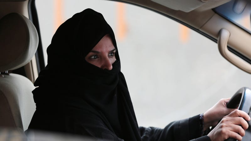 Aziza Yousef drives a car on a highway in Riyadh, Saudi Arabia, Saturday March 29, 2014, as part of a campaign to defy Saudi Arabia's ban on women driving. Photo via AP Images.