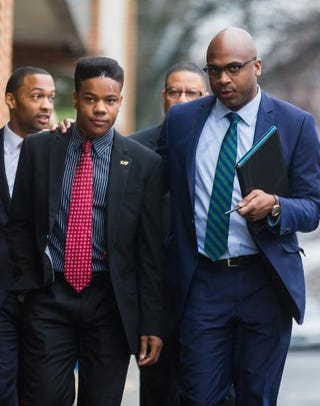 University of Virginia student Martese Johnson (second left) and his lawyer, Daniel Watkins (right), walk to the Charlottesville District Court in Virginia before Johnson's hearing March 26, 2015.Zach Gibson/Getty Images