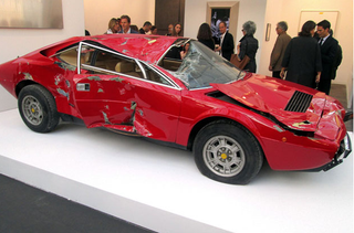 Illustration for article titled A Totaled Ferrari As A Sculpture In My House??? WANT.