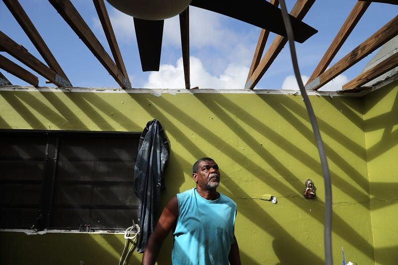 Carmelo Mota searches for tools in his destroyed bedroom more than a week after Hurricane Irma made landfall Sept. 18, 2017, in Charlotte Amalie, St. Thomas, U.S. Virgin Islands. Mota is a builder and said that Irma's ferocious strength has made him completely rethink how he will construct houses in the future. (Chip Somodevilla/Getty Images)