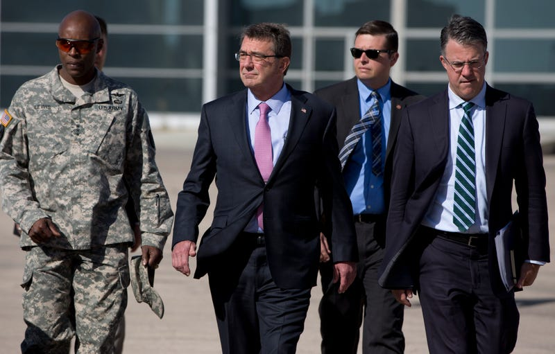 Defense Secretary Ash Carter (second from left), accompanied by then-U.S. Army Lt. Gen. Ron Lewis (left) and Chief of Staff Eric Rosenbach (right) in 2015 in Amman, Jordan.Carolyn Kaster-Pool/Getty Images