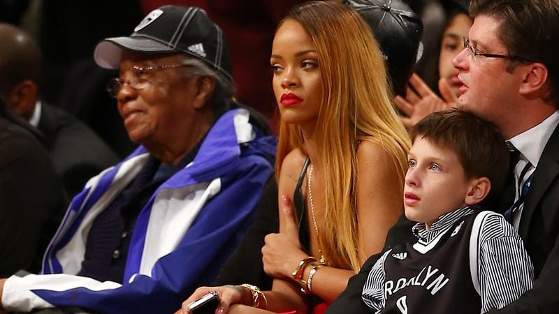 Illustration for article titled Rihanna and This Dead-Eyed Child Commiserate About Boredom