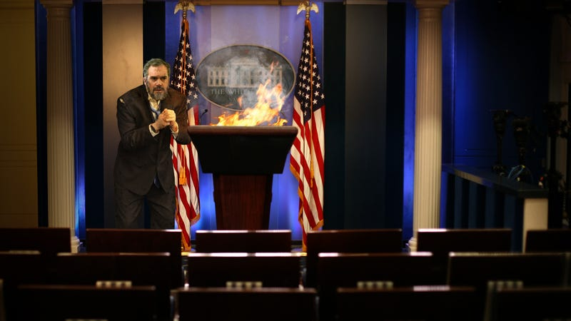 Illustration for article titled Emaciated Peter Alexander Burns Podium For Warmth After Being Locked In Abandoned Press Briefing Room Since December