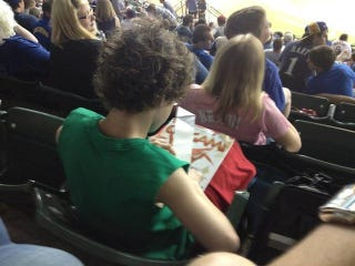 Illustration for article titled Today In Disinterested Baseball Fans: A Kid Doing Origami