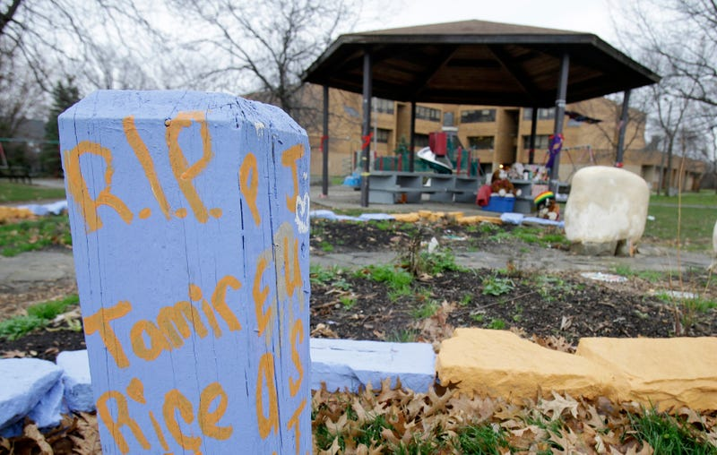 """R.I.P. Tamir Rice"" is written on a wooden post near a makeshift memorial at the gazebo where the boy was fatally shot, outside the Cudell Recreation Center in Cleveland on Nov. 22, 2014."