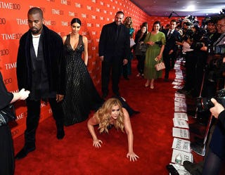 Illustration for article titled Watch Amy Schumer (Red) Carpet Bomb Kanye West and Kim Kardashian