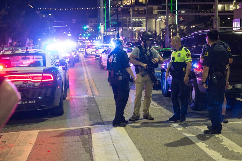 Police stand near a barricade following the sniper shooting in Dallas July 7, 2016, that left five police officers dead and six injured.LAURA BUCKMAN/AFP/Getty Images