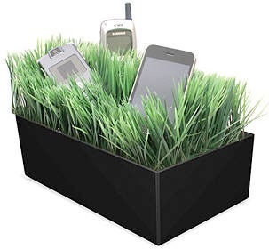 Grass Charging Valet Hides Unsightly Cables In Unsightly Fake Grass