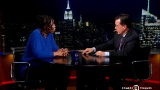 Naquasia LeGrand with Stephen Colbert during her appearance on The Colbert ReportYoutube