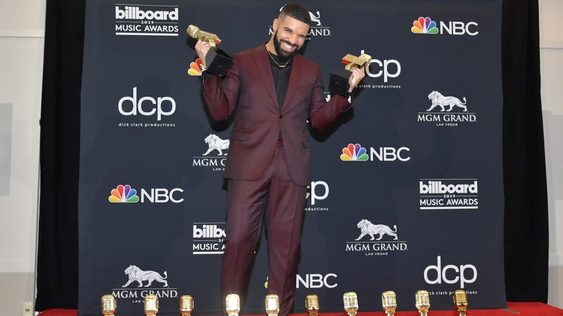 "Drake poses with the awards for Top Artist, Top Male Artist, Top Billboard 200 Album for ""Scorpion"", Top Billboard 200 Artist, Top Hot 100 Artist, Top Streaming Songs Artist, Top Song Sales Artist, Top Rap Artist, Top Rap Male Artist in the press room during the 2019 Billboard Music Awards on May 01, 2019 in Las Vegas, Nevada."
