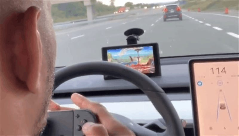 UFC Fighter Plays Smash While His Tesla Drives Itself