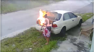 Carmen Chamblee was reportedly seen on video feeding a fire that was set in the trunk of a car. WTSP screenshot