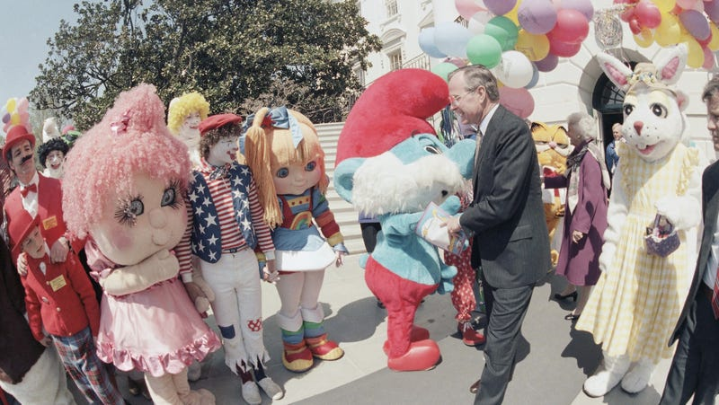 U.S. Vice President George H. Bush greeted by cartoon characters at the start of the annual Easter egg roll on the White House, April 8, 1985 in Washington. (AP Photo)