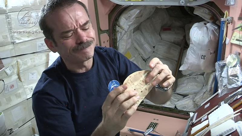 Astronaut Chris Hadfield enjoying a tortilla. (Image: Screen Shot via YouTube)