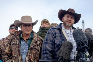 Ammon Bundy (right), leader of a group of armed anti-government protesters who took over the Malheur National Wildlife Refuge near Burns, Ore., speaks to the media as other group members look on Jan. 4, 2016.Robb Kerry/Getty Images