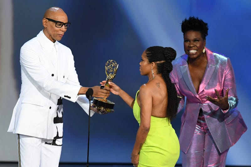 Regina King (c) accepts the Outstanding Lead Actress in a Limited Series or Movie award for 'Seven Seconds' from RuPaul (L) and Leslie Jones (R) onstage during the 70th Emmy Awards on September 17, 2018 in Los Angeles, California.
