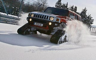 Illustration for article titled Hummer H3 + Tracks + Snow-Covered Nurburgring = Heroic Win