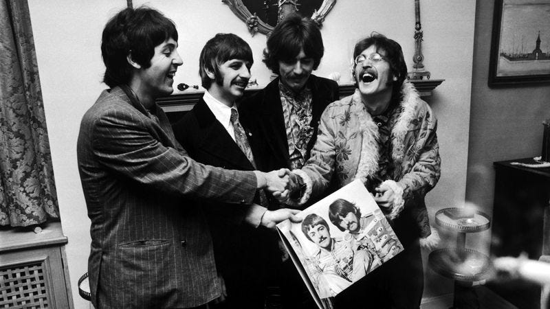 The Beatles hold the sleeve of Sgt. Pepper's Lonely Hearts Club Band, at the press launch for the album, held at Brian Epstein's house in London, May 19, 1967. (Photo: John Downing/Getty Images)