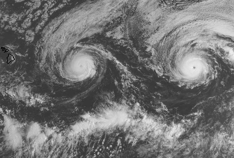 Hurricane Madeline (left) and Lester (right) churning toward Hawaii on Monday. Image: NASA via Weather Underground