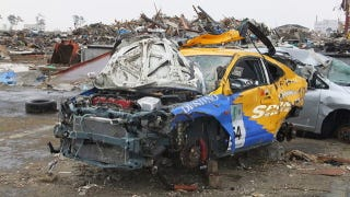 Illustration for article titled Did looters take the wheels from this Tsunami-devastated racecar?