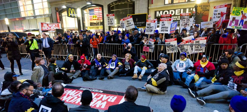 A crowd of about 350 protesters stand on Broadway in front of a McDonald's restaurant, Tuesday, Nov. 29, 2016, in New York. Image credit: Mark Lennihan/AP