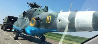 Illustration for article titled Ukrainian Mi-24 Hind Shot Down, Towed Away By Truck