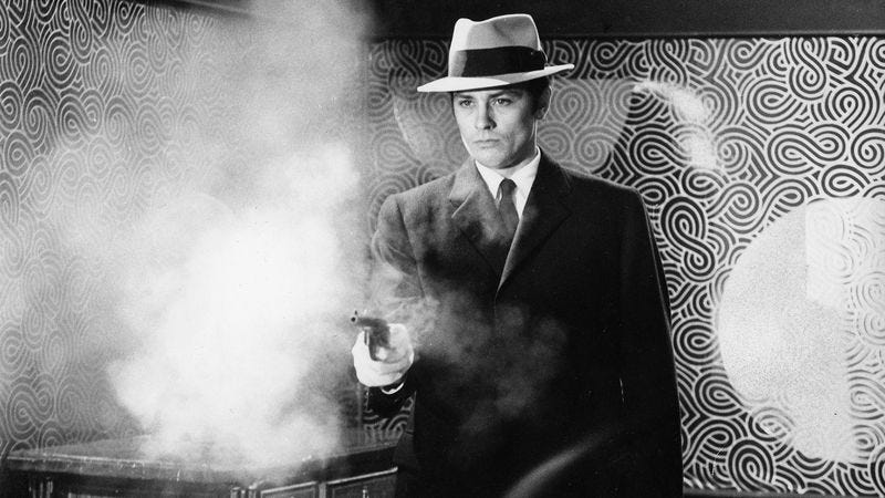 Alain Delon fires a prop pistol on the set of Le Samouraï. (Photo: ullstein bild via Getty Images)