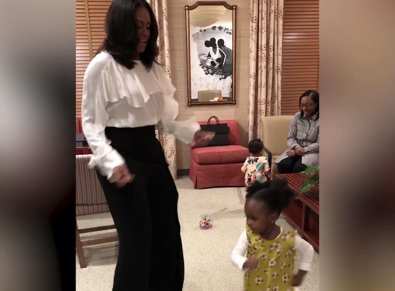 Michelle Obama and Parker Curry dance it up.