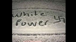 "One of the ""white power"" messages seen marked in snow on a car on Calvin College's campus in MichiganFacebook"