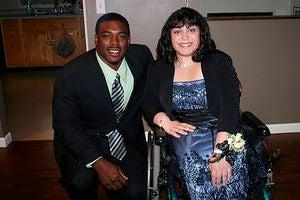 NFL rookie linebacker J.T. Thomas escorts student to dance. (Google)