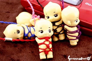 Illustration for article titled Kewpie Bondage Cellphone Charms Give Us Utterly Horrific Nightmares