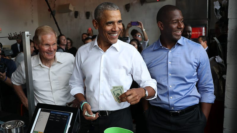 Former U.S. President Barack Obama orders lunch with Florida Democratic gubernatorial candidate Andrew Gillum and U.S. Senator Bill Nelson (D-FL) at the Coyo Taco restaurant on November 02, 2018 in Miami, Florida.