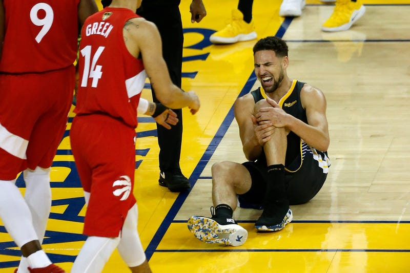 Klay Thompson of the Golden State Warriors reacts after hurting his leg in the second half during Game Six of the 2019 NBA Finals against the Toronto Raptors on June 13, 2019 in Oakland, Calif.