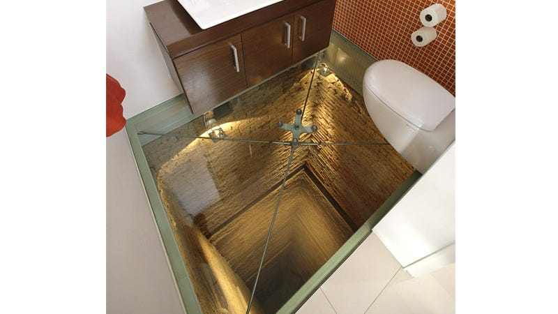 Illustration for article titled This Toilet Is the Perfect Place To Sit When Perched On a Glass Floor Over a 15 Story Shaft