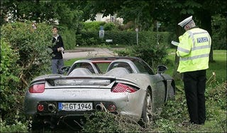 Illustration for article titled F1 Star Lewis Hamilton's Dad Crashes Porsche Carrera GT, Shows He's Like Son