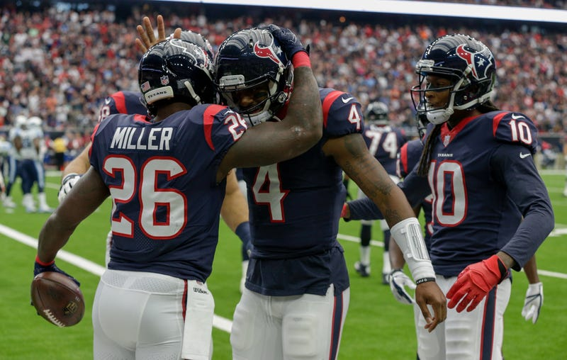 Deshaun Watson, No. 4 of the Houston Texans, celebrates with Lamar Miller, No. 26, and DeAndre Hopkins, No. 10, after a first-quarter score against the Tennessee Titans at NRG Stadium on Oct. 1, 2017, in Houston. (Bob Levey/Getty Images)