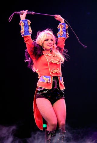 Illustration for article titled Drunk Fan Rushes Britney On Stage; Pattinson Has Penis Implant?