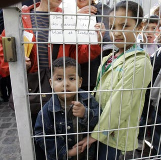In front of a primary school outside Paris, where two children of Algerian illegal immigrants had been detained, September 2005, Pantin, FranceJACK GUEZ/AFP/Getty Images