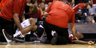 Kevin Ware is tended to by medical professionals. (Getty Images)