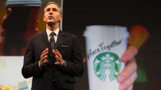 Starbucks Chairman and CEO Howard Schultz addresses the Race Together campaign during the Starbucks annual shareholders meeting March 18, 2015, in Seattle. Stephen Brashear/Getty Images