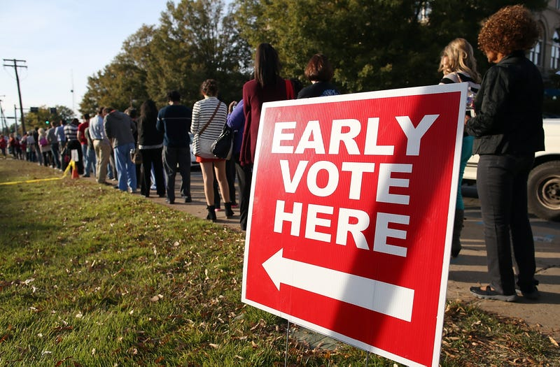 People line up for early voting outside the Pulaski County Regional Building on Nov. 3, 2014, in Little Rock, Ark.Justin Sullivan/Getty Images