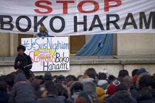 "Demonstrators hold placards and banners reading ""I Am Nigerian"" (left) and ""Stop Boko Haram"" during a gathering in Paris Jan. 18, 2015, to protest the terror group.  LIONEL BONAVENTURE/AFP/Getty Images"