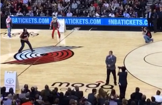 Illustration for article titled Blazers Fan's Half-Court Shot Is Confounding And Terrible