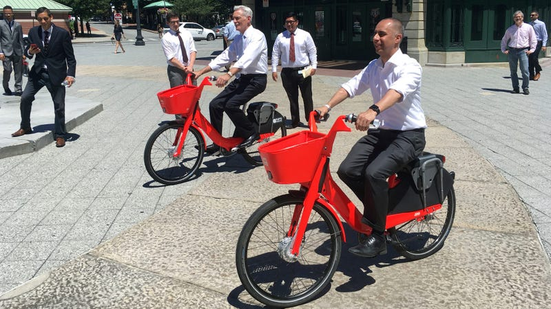 Mayor Jorge Elorza, right, riding an Uber Jump bike with Tufts Health Plan CEO Tom Croswell in in Providence, Rhode Island in July 2018.