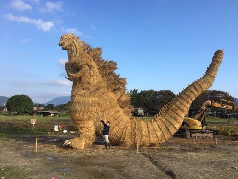 an enormous godzilla made of straw appears in japan